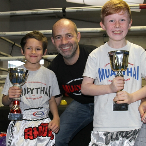 Ace and Drai winning trophies for most improved and best attitude to training