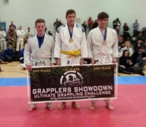 Gold medalist George (centre) and Silver Medalist Josh (left) win Crawley's BJJ Team their first medals of the day