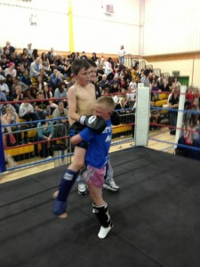 Jack West is lifted by his opponent